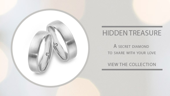 Hidden treasure classic wedding rings with a secret diamond inside the wedding rings band for LGBT couples