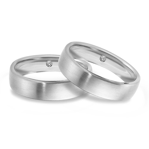 Diamond inside unusual wedding ring hidden treasure for Gay and Lesbian couples from Woolton & Hewitt the LGBT jeweller UK
